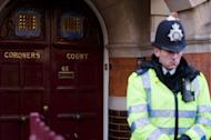 A police officer stands outside Westminster coroners court in central London on December 13, 2012, on the morning of the opening of the inquest into the death of Jacinda Saldanha. Saldanha, a nurse at the hospital treating Prince William's pregnant wife Catherine, was found hanged in her room after being duped by a hoax call from an Australian radio station, the inquest heard Thursday