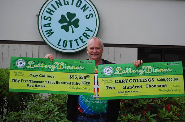 Cary Collings holds up his winnings (Photo via Facebook)