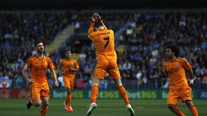 Real Madrid's Ronaldo celebrates after scoring a goal against Malaga during their Spanish First Division soccer match in Malaga