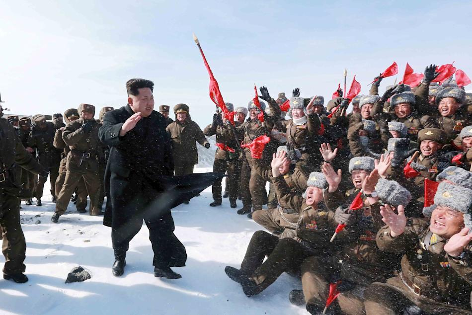 North Korean leader Kim Jong Un greets Korean People's Army pilots during a visit to the summit of Mt Paektu
