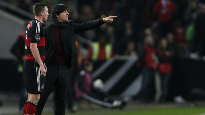 Germany's national soccer coach Loew instructs Grosskreutz during their international friendly soccer match against Chile in Stuttgart