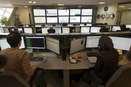 Technicians monitor data flow in the control room of an internet service provider in Tehran February 15, 2011. . REUTERS/Caren Firouz