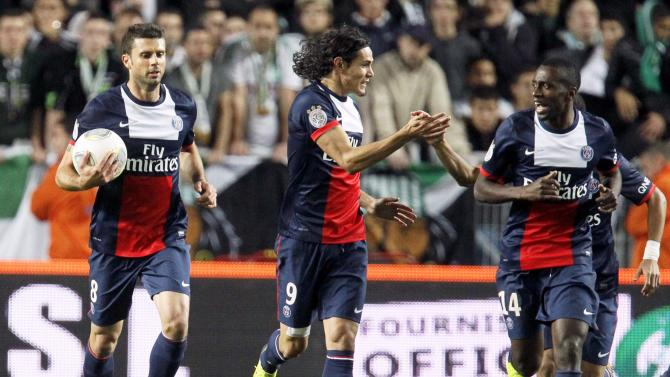 Cavani of Paris St-Germain celebrates with teammates after scoring against St Etienne during their French Ligue 1 soccer match in Saint-Etienne