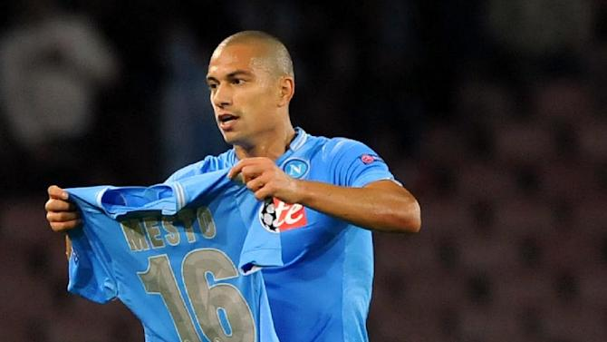 Napoli's Gokhan Inler celebrates after scoring during a Champions League, group F, soccer match between Napoli and Marseille, at the Naples San Paolo stadium, Italy, Wednesday, Nov. 6, 2013