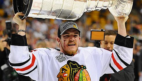 2013 Stanley Cup Final: Chicago Blackhawks' Andrew Shaw hoists the Cup