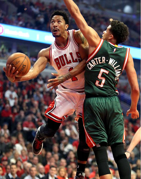 Chicago Bulls guard Derrick Rose drives on Milwaukee Bucks guard Michael Carter-Williams during  Game 5 of the NBA basketball playoffs Monday, April 27, 2015, in Chicago. The Bucks won 94-88. (Steve L