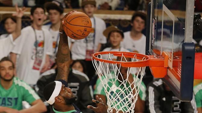 East Team's LeBron James, of the Miami Heat (6) dunks the ball against the West Team during the NBA All Star basketball game, Sunday, Feb. 16, 2014, in New Orleans