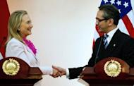 US Secretary of State Hillary Clinton (L) shakes hands with Indonesian Foreign Minister Marty Natalegawa during a joint press conference at the Ministry of Foreign Affairs in Jakarta. Clinton travels to China after sounding an optimistic note in Southeast Asia's largest nation Indonesia