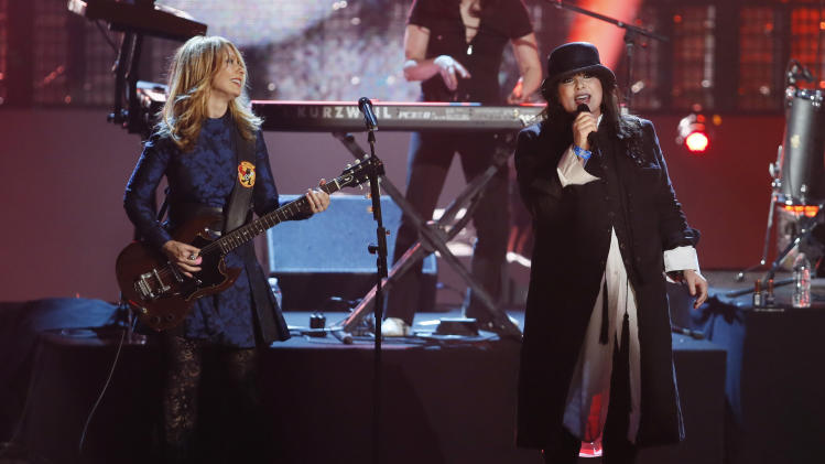Nancy Wilson, left, and Ann Wilson, right, of the band Heart perform as Heart is inducted into the Rock and Roll Hall of Fame during the Rock and Roll Hall of Fame Induction Ceremony at the Nokia Theatre on Thursday, April 18, 2013 in Los Angeles. (Photo by Danny Moloshok/Invision/AP)