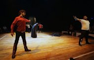 "Actors from the Iraqi Theatre Company perform a scene from ""Romeo and Juliet in Baghdad"" during rehearsals for the World Shakespeare Festival. Romeo is Shiite, Juliet Sunni, and they must contend not only with warring families but a country torn by conflict and sectarian strife: this is the story of the play"
