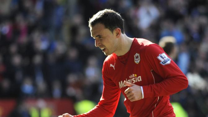 Cardiff City's Jordon Mutch celebrates scoring a goal against Liverpool during their English Premier League soccer match at Cardiff City Stadium in Cardiff