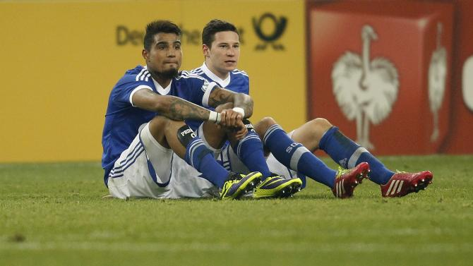 Schalke 04's Boateng and Draxler react after their third round German soccer cup (DFB-Pokal) match against Hoffenheim in Gelsenkirchen