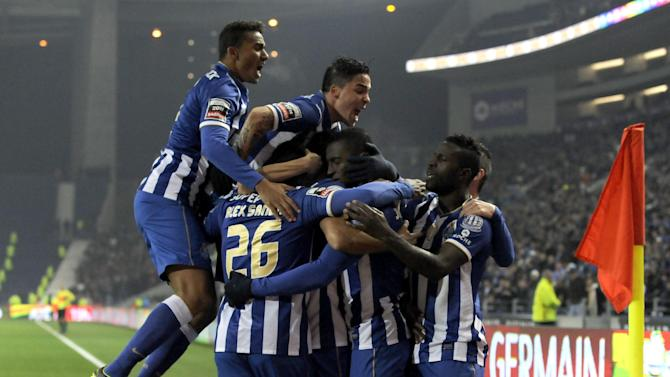 FC Porto's Jackson Martinez, center, from Colombia his mobbed by teammates as they celebrate scoring the opening goal against Sporting Braga in a Portuguese League soccer match at the Dragao Stadium in Porto, Portugal, Saturday, Dec. 7, 2013