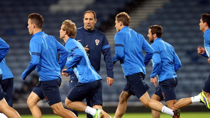 Croatia's manager Igor Stimac, centre left, watches his squad during a team training session at Hampden Park, Glasgow, Scotland, Monday Oct. 14, 2013. Croatia face Scotland in a World Cup qualifying Group A  soccer match on Tuesday