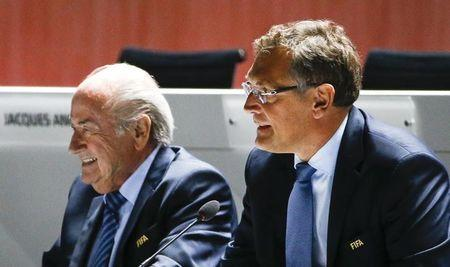 FIFA President Blatter arrives with Valcke, Secretary General of the FIFA, at the 65th FIFA Congress in Zurich