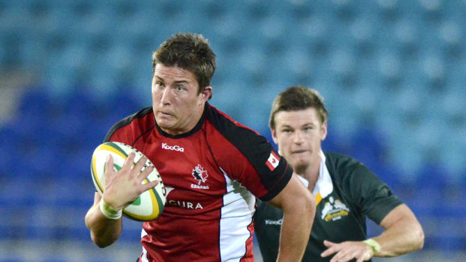 Canada's DTH Van der Merwe makes a break during their rugby union match againts the Australia Barbarians on the Gold Coast, Australia, Friday, Aug. 26, 2011. (AP Photo/Steve Holland)