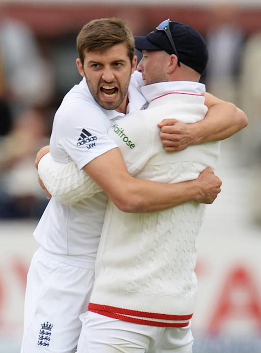 Cricket: England's Mark Wood celebrates with Adam Lyth after dismissing New Zealand's Corey Anderson