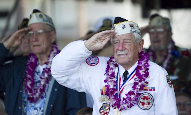 Pearl Harbor survivors stand at attention during the National Anthem during the Pearl Harbor memorial ceremony, Wednesday, Dec. 7, 2011, in Pearl Harbor, Hawaii. Today marks the 70th anniversary of th