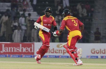 Zimbabwe's captain Chigumbura and Masakadza run between the wickets during the first One Day International cricket match between Pakistan and Zimbabwe at the Gaddafi Cricket Stadium in Lahore