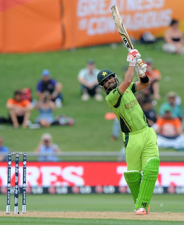 Pakistan's Ahmad Shahzad watches as he hits the ball to the boundary while batting against the United Arab Emirates during their Cricket World Cup Pool B match in Napier, New Zealand, Wednesday, M