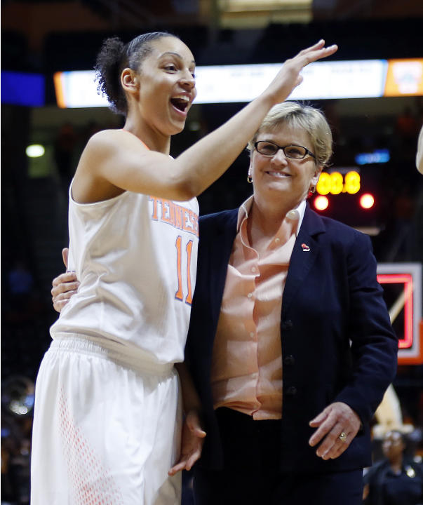 Tennessee head coach Holly Warlick leaves the court with forward Cierra Burdick (11) after an NCAA women's college basketball second-round tournament game against St. John's Monday, March 24,