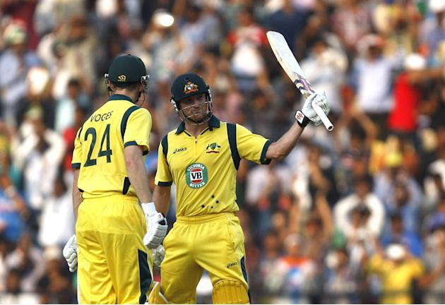 George Bailey lifts his bat after his 150 runs as Adam Voges stands on the other end during the 6th ODI between India and Australia Vidarbha Cricket Association Stadium, Jamtha in Nagpur on Oct.30, 20