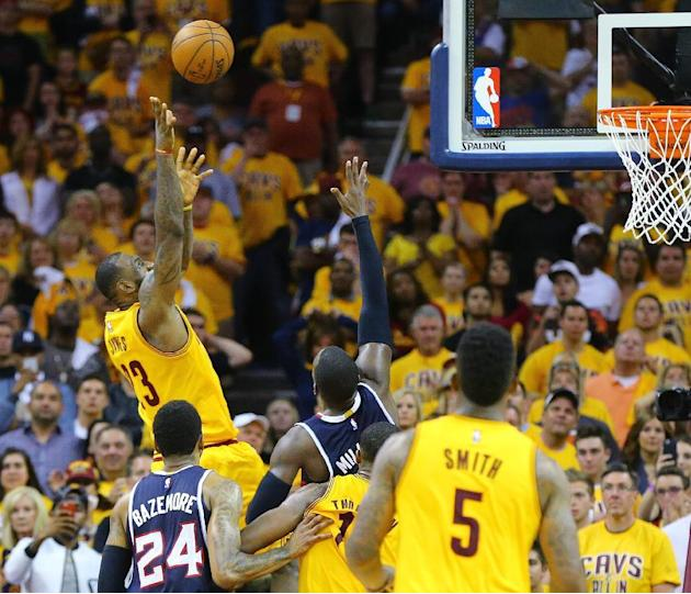 Cleveland Cavaliers' LeBron James shoots over Atlanta Hawks' Paul Millsap in overtime in Game 3 of the Eastern Conference finals of the NBA basketball playoffs Sunday, May 24, 2015, in Clevela