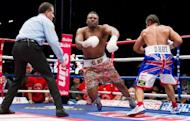 Dereck Chisora (C) falls to the canvas after David Haye lands a final punch that ends the WBO International and WBA Intercontinental Heavyweight Championship fight at the West Ham football stadium in east London, on July 14. Haye won the match in the fifth round