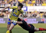 Clermont's French fly-half David Skrela (left) rides the ball during the French Top 14 rugby Union match against Stade Toulousain at the stadium Marcel Michelin in Clermont-Ferrand, March 2012. Skrela has been ruled out of Clermont's European Cup semi-final against Irish province Leinster, the Top 14 side's coach Vern Cotter said