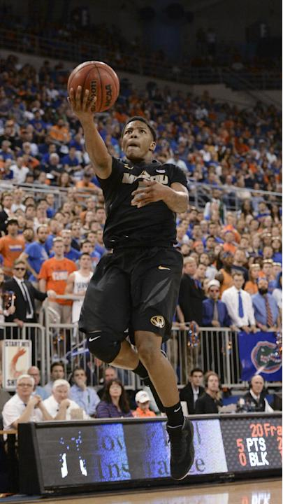 Missouri guard Wes Clark goes up to the basket during the second half of an NCAA college basketball game against Florida on Tuesday, Feb. 4, 2014, in Gainesville, Fla. Florida defeated Missouri 68-58.