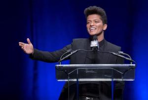 Singer Bruno Mars speaks at the Super Bowl half time press conference in New York