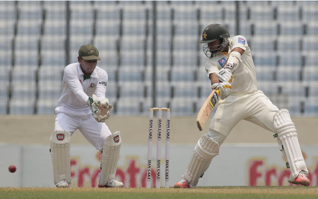 Pakistan's Azhar Ali, right, plays a shot, as Bangladesh's wicketkeeper captain Mushfiqur Rahim watches during the first day of their second test cricket match in Dhaka, Bangladesh, Wednesday, May 6,