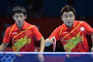 China's Wang Hao (R) and Zhang Jike return a ball to South Korea's Oh Sangeun and South Korea's Ryu Seungmin during the table tennis men's team final China vs South Korea at the London Olympic games on August 8, 2012 at the Excel arena in London. AFP PHOTO / SAEED KHAN