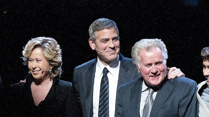 """From left to right, actress Yeardley Smith, actor George Clooney, and actor Martin Sheen take a bow during the curtain call at the Los Angeles premiere of the play """"8"""" in Los Angeles on Saturday, March 3, 2012. (AP Photo/Dan Steinberg)"""