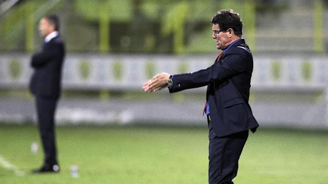 Russia's coach Fabio Capello instructs his players during a friendly match with Serbia in Dubai, United Arab Emirates, Friday Nov. 15, 2013