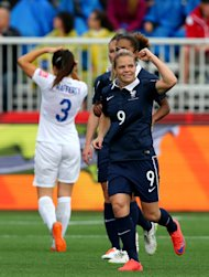 MONCTON, NB - JUNE 09: Eugenie Le #9 of France celebrates her goal in the first half against the England during the FIFA Women's World Cup 2015 Group F match at Moncton Stadium on June 9, 2015 in Moncton, Canada. (Photo by Elsa/Getty Images)
