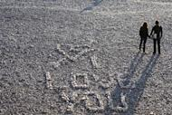 This file illustration photo shows people holding hands near an inscription reading 'I love you', made with stones, on Nice beach in southern France, on November 26, 2009. Asexuality is still largely misunderstood, particularly in countries where sex is splashed all over magazines, films and on television, and very few studies have been done on the subject
