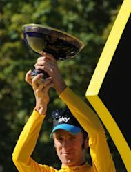 Bradley Wiggins, pictured on July 22, made a low-key return home Monday after his historic Tour de France win, even as Britain looked forward to the cyclist leading the country to more success at the London Olympics