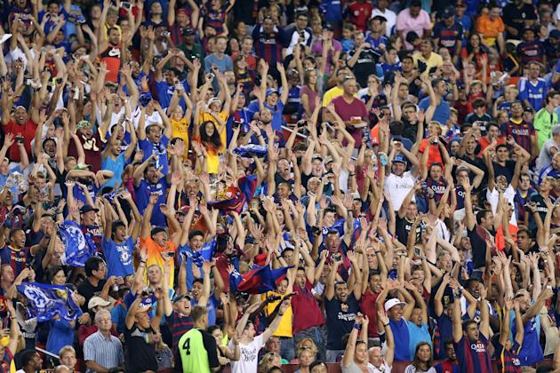 IMAGE DISTRIBUTED FOR INTERNATIONAL CHAMPIONS CUP - Fans in action on Tuesday, July 28, 2015, in Landover, Maryland. Chelsea and FC Barcelona face off at the 2015 International Champions Cup. (Damian