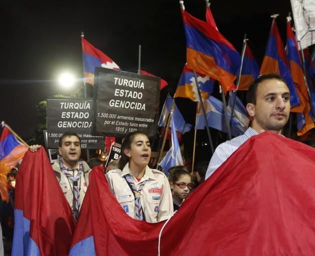 Members of the Armenian community in Argentina march toward the Turkey embassy in Argentina during a rally marking the anniversary of mass killings of Armenians in Ottoman Empire in 1915 in Buenos Air