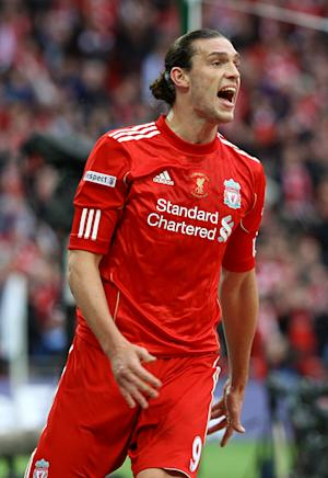 Robbie Fowler believes Andy Carroll (pictured) is burdened by his transfer fee