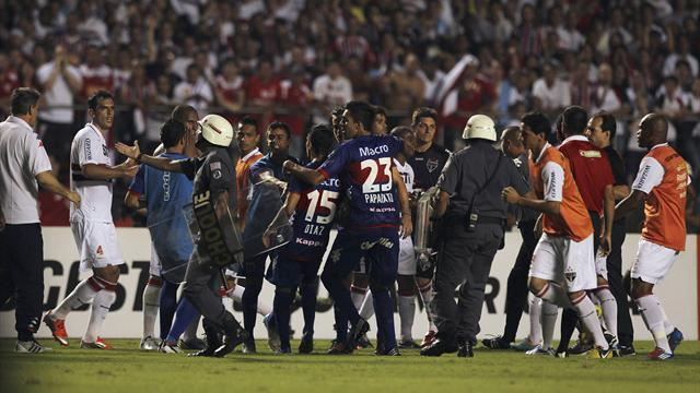 World Football - 'Police pull guns on players' in South America final