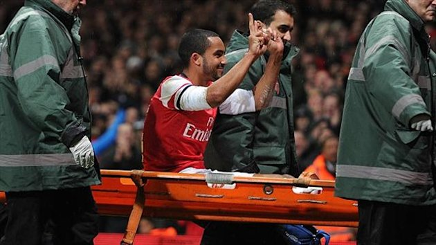Theo Walcott was pelted by missiles coming from the Tottenham fans