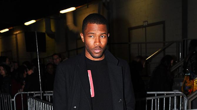 Singer Frank Ocean arrives at Givenchy's Ready to Wear's Fall-Winter 2013-2014 fashion collection presented Sunday, March 3, 2013 in Paris. (AP Photo/Zacharie Scheurer)