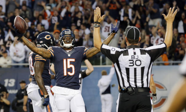 FILE - In this Aug. 14, 2014, file photo, Chicago Bears wide receiver Brandon Marshall (15) celebrates a touchdown reception against the Jacksonville Jaguars during the first half of an NFL preseason