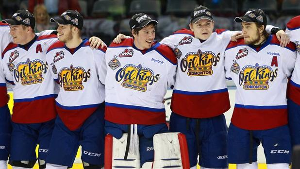 Edmonton Oil Kings players celebrate after beating the Guelph Storm in the championship game of the Memorial Cup CHL hockey tournament in London, Ont., on Sunday, May 25, 2014. The Oil Kings will have history on their side in this year's Western Hockey League playoffs - but not much else.The defending WHL and Memorial Cup champions hope to become a Cinderella team after taking a steep fall in the standings. THE CANADIAN PRESS/Dave Chidley