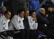Real Madrid's Portuguese coach Jose Mourinho (2nd R) reacts during their Spanish league football match against Malaga at the Rosaleda stadium in Malaga on December 22, 2012. Mourinho was under renewed pressure on Saturday after his team lost 3-2 at Malaga, a defeat which left the champions 16 points behind leaders Barcelona