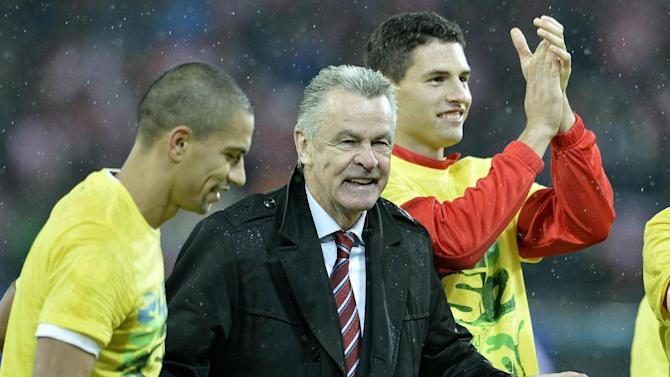 Switzerland's Goekhan Inler, head coach Ottmar Hitzfeld and Fabian Schaer, from left, celebrate after the FIFA World Cup 2014 group E qualifying soccer match between Switzerland and Slovenia at the Stade de Suisse stadium in Bern, Switzerland, Tuesday, October 15, 2013