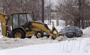 FILE - This Feb. 11, 2014 file photo shows work crews…