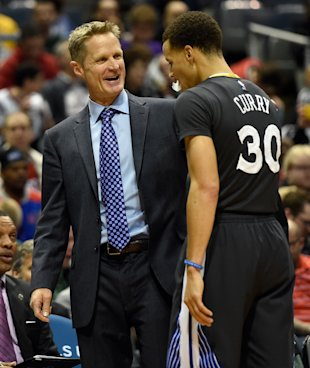 Mar 28, 2015; Milwaukee, WI, USA; Golden State Warriors head coach Steve Kerr reacts with guard Stephen Curry (30) in the fourth quarter during the game against the Milwaukee Bucks at BMO Harris Bradley Center. The Warriors beat the Bucks 108-95. (Benny Sieu-USA TODAY Sports)